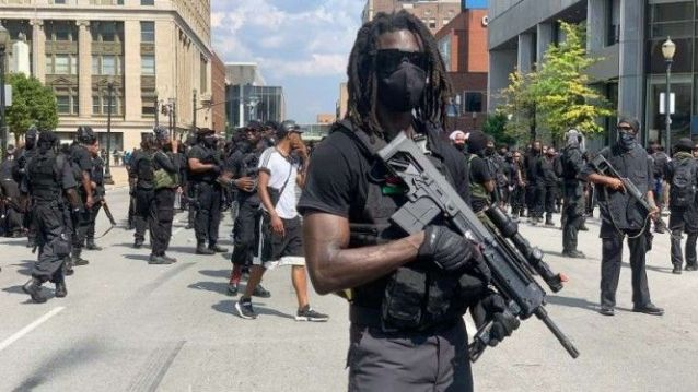 "Kelompok bersenjata serba hitam yang mengklaim bernama ""Not Fucking Around Coalition"" (NFAC)."