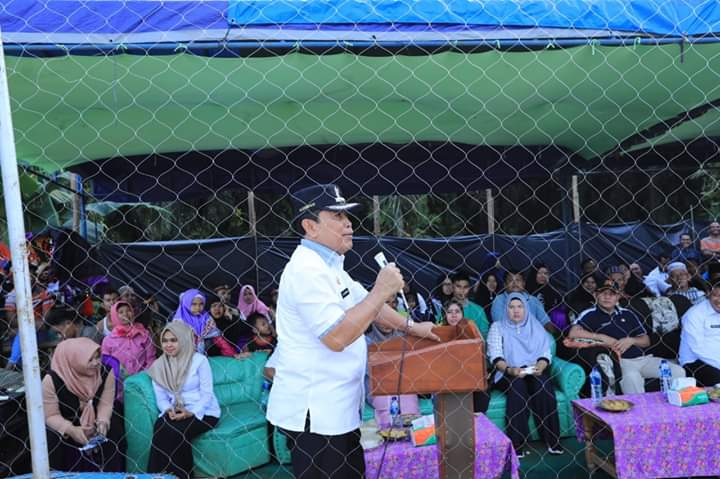 Bupati Rohul H.Sukima, membuka Open Turnamen volly  ball, di Desa Rambah Jaya, Kecamatan Bangun Purba.
