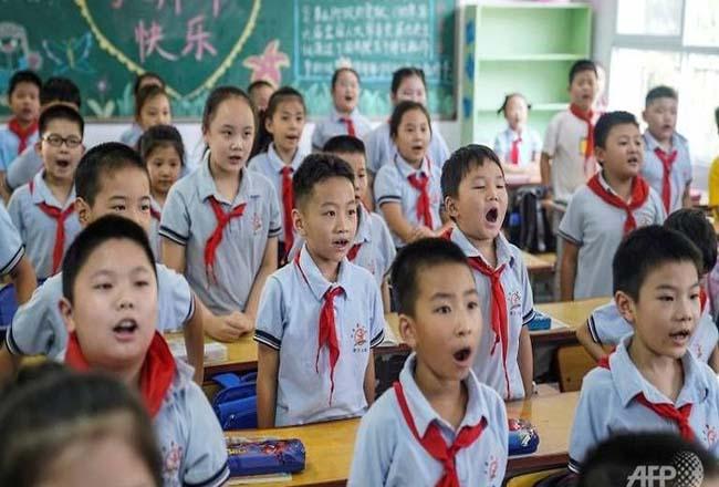 Siswa di Wuhan, China sudah mulai masuk kelas lagi. Foto: CNNIndonesia