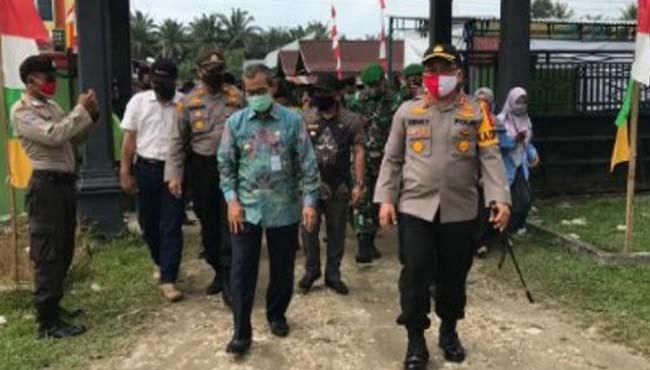 Kapolres Kuansing AKBP Henky Poerwanto, SIK, MM melaunching Gerakan Jaga Kampung Polres Kuansing. FOTO: Siagaonline.com.