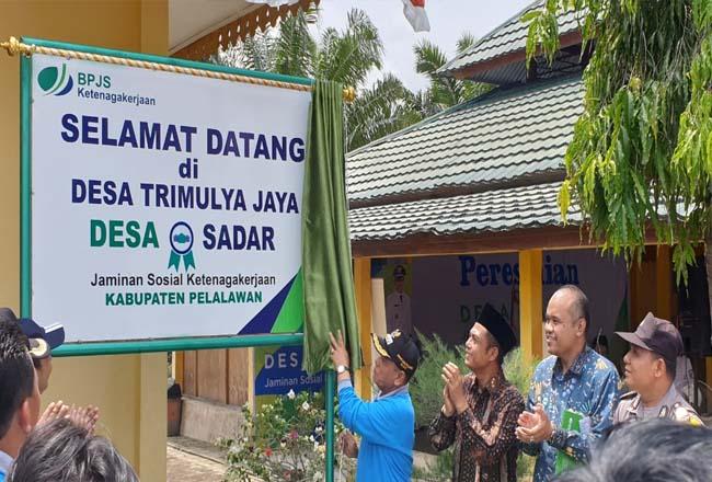 Peresmian Desa Trimulya Jaya Kecamatan Ukui sebagai Desa Sadar BPJS Ketenagakerjaan.