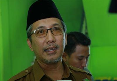 Fikrizon, Kepala Tata Usaha (TU) SMK Muhammadiyah 3 Pekanbaru.