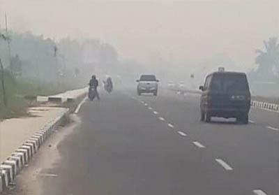 Kabut asap di Kuansing. FOTO: Riau1