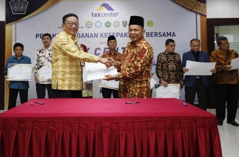 DJP Provinsi Riau, lakukan penandatanganan peningkatan kualitas layanan dan konsultasi perpajakan dengan sembilan perguruan tinggi di Bumi Lancang Kuning, Kamis (12/12/2019).