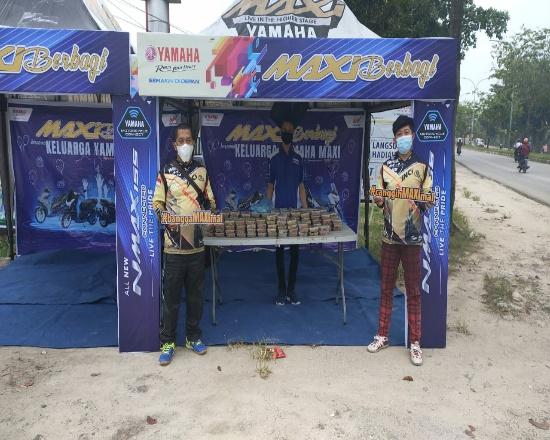 Maxi berbagi sarapan gratis untuk warga Pekanbaru.
