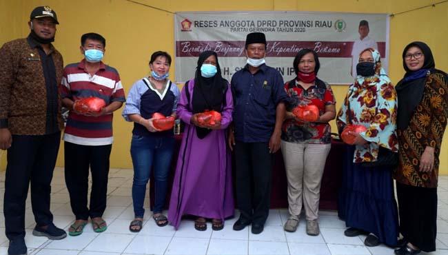 Anggota DPRD Provinsi Riau, H Syafruddin AMp reses dengan mensosialisasikan upaya pencegahan Coronavirus Desease (Covid-19) di Daerah Pemilihan (Dapil) Rokan Hilir (Rohil).