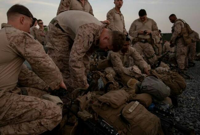 Ilustrasi tentara Amerika Serikat (AS) yang tengah melakukan persiapan. Foto: Kompas