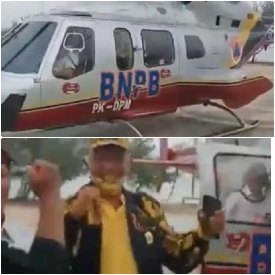Tangkapan layar video viral Ketua DPRD Riau Indra Gunawan saat turun dari helikopter BNPB di Kabupaten Bengkalis, Riau, Senin (24/8/2020). FOTO: Inews/Indra Yosserizal