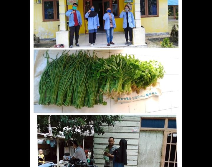 Pembagian sayur gratis kepada warga.
