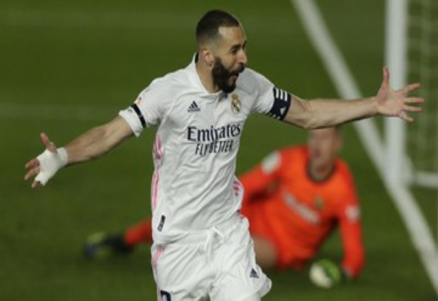 Selebrasi penyerang Real Madrid Karim Benzema. Foto: CNNIndonesia