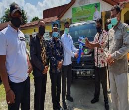 Bupati Rohul H Sukiman, Plt Kakanwil Kemenag Riau Kepala Biro Kesra Setda Riau, Sekda Rohul dan Forkompinda, menekan tombol menandai dibukanya MTQ XIX Rohul 2019