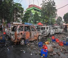 Cars that were burned by protesters are seen during an overnight demonstration near by the Elections Oversight Body (Bawaslu) in Jakarta. PHOTOGRAPH: Bay Ismoyo/AFP/Getty Images